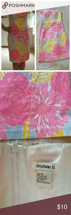 Strapless, floral Stephanie B dress This one is so pretty on,  it's bright and colorful! It's a size 4, but runs very small (more of a 0 or 2 size) there are 3 small spots on the bottom of the front, so it will need cleaning; reflected in the price. Doesn't fit me as nicely after having a baby as it did before. stephanie b  Dresses Strapless