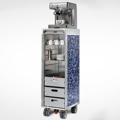 """Airline food carts reborn as SKYPAK: """"It is slender, smart and stylish—gives you itchy feet and is reminiscent of the sound of turbines, the travel bug and airy heights. We are talking about the highly maneuverable and functional Airline Trolleys, the mini bars on wheels in airplanes. Guided by friendly flight attendants, they were invented to help pass the time on long-distance and scheduled flights and provide passengers time and again with an astonishing range of delicacies."""""""