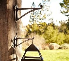 "Wall-Mounted Lantern Hook #potterybarn  Small: 1.75"" wide x 7.25"" deep x 4.25"" high  Large:  2.5"" wide x 10"" deep x 6.5"" high  $14-19"