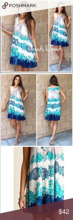 Ombre Shift Dress Floral Medallion Ombré Shift Dress  PRODUCT DESCRIPTION   • mixed floral & medallion prints with an ombré printed accent • rounded scoop neckline with cross over strap detail • sleeveless  • relaxed, easy fit • soft, breathable material   Material Content: Rayon   Primary Color: White (base color) Secondary Colors: Stunning hues of Aqua's and Blue's   Dress Type: Shift, Tunic, Mini, Chemise. Embellished lilac Dresses