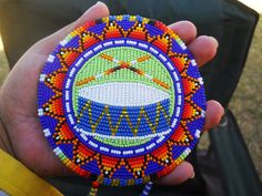 Pow Wow Drummers Medallion by WaterbirdsRainbowz (Marlyssa Ann, Diné) on Etsy: This medallion was made in honor of my fathers design Cornersprings Designs  it shows the drum and the sticks, with a circle triangle surrounding meaning life and continuation of the drum and it's sining
