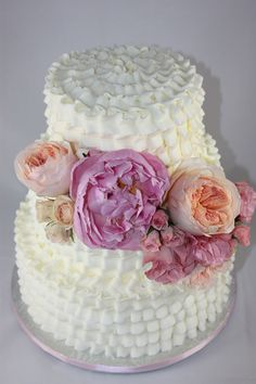 - White ruffle buttercream cake with fresh peony and garden roses (Classic Creations Floral Design)  This was a display cake for a bridal expo