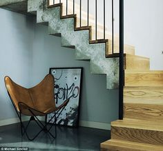 'The stairs connect the ground floor to the new basement. We wanted a modern design with industrial cues.' The result is concrete and oak steps with a bespoke metal handrail. The butterfly chair was bought in Argentina; the poster at a vintage fair Metal Handrails, Hallway Inspiration, Basement Kitchen, Entry Hallway, South London, Butterfly Chair, Victorian Homes, Stairways, Modern Design