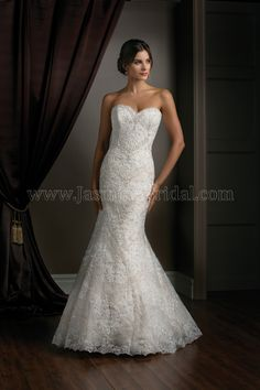 Jasmine Couture Wedding Dress Style T172017 in Ivory-Gold. This sexy tulle dress is upgraded with a layer of luxuriously beaded and embroidered Venise lace. Set on a strapless sweetheart neckline and fit and flare skirt, this dress is only for the most discerning bride on her wedding day.