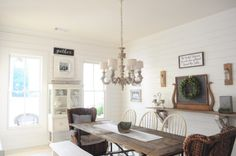 White Farmhouse Dining Room with Shiplap Walls and Rustic Wood Farm Table