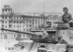 Pz Kpfw III Ausf. L on the main city square of Voronezh (Ploshchad' Lenina - Lenin's square, founded in 1937 and named in memory of the 20th anniversary of the October Revolution), in front of Voronezh Hotel. The hotel was constructed during the thirties, and was re-build after the war, after being damaged during the German invasion. The camouflage pattern on this Pz Kpfw III indicates that it was originally bound for North Africa.16. Infanterie-Division (motoriziert)