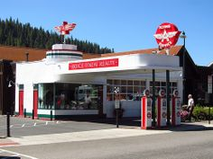 This Service Station first opened in Today a real estate office occupies the building, and it has been restored to it's 1949 Flying A appearance. Driving Route 66, Chevron Gas, Truckee California, Pompe A Essence, Radiator Springs, Garage Repair, Vintage Gas Pumps, Gas Service, Real Estate Office