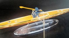 Kayak model, Nautical gift, gift for him, Kayak sculpture, Maritime art, Gift for him, Home decor, Cool art, Collectors art.  This small sized transparent kayak model , made of laser-cut acrylic glass, is a great gift for your boater friend, or for anyone appreciating clean, streamlined modern design.  The materials characteristics allow for a beautiful durable crystalline sheen. It will create an amazing focal point on your office desk or at home.  All parts are assembled meticulously by…