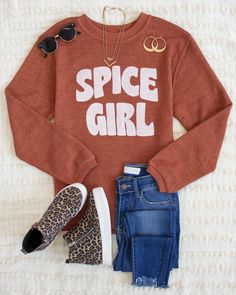 This sassy graphic sweatshirt is made for relaxing weekend days or perfect for making errands! The light orange color is paired with bold lettering - it's such a chic style to rock all fall long! We love the lightweight and soft material - it's so easy to wear all day long!