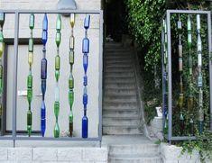 wine bottles garden fence colorful glass idea garden decoration