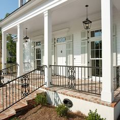 New Orleans Charm with a Private Courtyard - Traditional - Porch - new orleans - by Highland Homes, Inc. Wrought Iron Porch Railings, Front Porch Railings, Brick Porch, Porch Columns, Porch Steps, Porch Banister, Columns Decor, House Columns, Traditional Porch