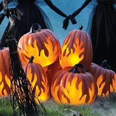 Take your jack-o'-lantern statement to a hot new dimension with our Lighted Flame Pumpkins. Not only are they cool to look at, but lasting materials mean recreating the scene each Halloween is as simple as flipping a switch. Each bright orange, battery-operated pumpkin features a unique flame pattern on one side. Turn them on, and as the interior LEDs begin to flicker, it creates the spine-tingling illusion of real flames. Flames appear to be artfully hand-sculpted, and natural stem shapes…