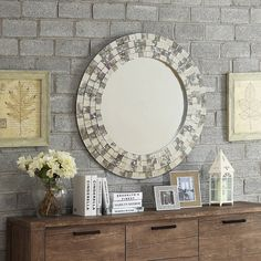Showcase distinctive style with the Nihoa Mirror Collection. Frosted tiles form a mosaic of texture around the large round center mirror. The frame features hints of mottled brown and grey, creating a warm tone.