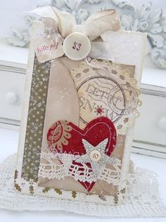 Shabby Snow Card...with a stitched heart, lace, bow, & glittered star.