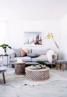 relaxed bohemian living room ideas with cowhide rug and round moroccan coffee tables