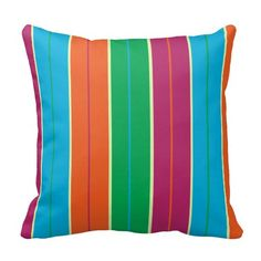 A colorful throw pillow with a spilt complementary pinstripe in stripes pattern in orange, blue, magenta and green