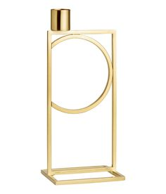 Check this out! Tall metal candlestick with a platform made from joined, flat bars. Diameter of candle holder 1 in. Size of candlestick 2 3/4 x 3 1/4 x 8 in. - Visit hm.com to see more.