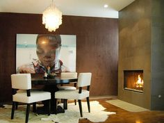 Dark brown suede walls, ivory upholstery and a shimmering, capiz shell chandelier. Love this look! http://blog.hgtv.com/design/2012/11/01/cuddle-up-to-novembers-color-of-the-month/