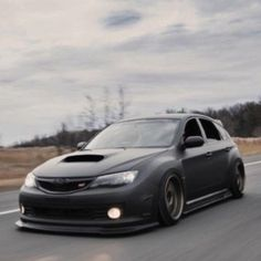 the car that Lord Vader would drive if he were a tuner--Subaru WRX STI