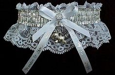 A Place for Girls. Shiny SILVER Metallic Fancy Bands™ Garter on white lace with a silver 'Teddy Bear' Charm and personalized imprinted ribbon tails. Wedding - Bridal - Prom - Fashion Fun Garter. Visit: www.garters.com/page37d.htm