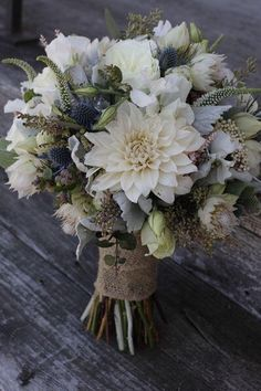 White dahlia, blue thistle, white Veronica, seeded eucalyptus and dusty miller bouquet. (Lovely technique, texture and style. Really like this bouquet! Dusty Miller Bouquet, Floral Wedding, Wedding Colors, Wedding Blue, Flowers For Navy Wedding, Bridal Flowers, White Dahlias, White Flowers, Flowers Uk