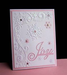 I love pink Christmas cards - or any of the unconventional colors.  This is for my SIL who loves everything pink and glitzy.  Used my favorite winter EF (Darice Snowflake Scroll Corner), and two dies: FS/Snowflake Flurries and PTI/One Liners.  The two tiny pink flakes are from MS/Snowflake border punch.  I covered the sentiment, every flake and all the embossed area with glitter glue.