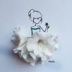 Un fiore bianco è un abito vaporoso VIRGOLA by Virginia Di Giorgio
