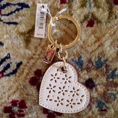 """Coach cream heart leather keychain NWT Cream laser-cut  leather keychain, gold hardware, approx 3.5"""".  NWT Coach Accessories Key & Card Holders"""