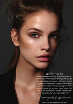 Soft dewy makeup. Bronzed cheeks, bold brows, and a pop of matte bright pink on the lips.
