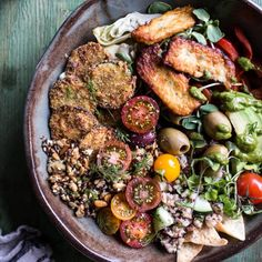 """Greek Goddess Grain Bowl with """"Fried"""" Zucchini, Toasted Seeds and Fried Halloumi. Veggie packed, healthy and easy!"""