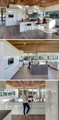 This mostly-all white kitchen is broken up by a dark countertop on the island and backsplash. The kitchen island is large enough to seat multiple people, ideal for entertaining. Modern Kitchen Island, All White Kitchen, Kitchen Islands, Diy Kitchen, Kitchen Ideas, Kitchen Decor, Rustic Kitchen, Luxury Kitchen Design, Interior Design Living Room