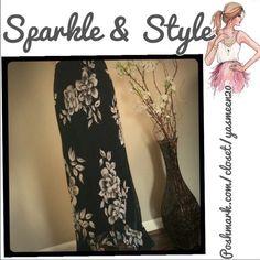 Elegant dressy skirt Black skirt with elegant cream flowers. Attached slip. Semi hi/lo ruffled bottom. Great for an evening event! Skirts