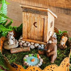 Forest Lane Set www.teeliesfairygarden.com . . . Lead your fairies to this ethereal Forest Lane set and they will thank you for it. It includes a cute crescent moon outhouse, fishing bear on a pond, raccoon, squirrel and an adorable log sign. #fairycamping