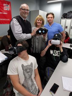 BORIS MINKEVICH / WINNIPEG FREE PRESSManitoba Construction Sector Council executive director Carol Paul, centre with Bruce Cielen (back left) of the Workers Compensation Board and Chris Taran (back right) of the International Brotherhood of Electrical Workers local 2085 training facility using a virtual reality training application.