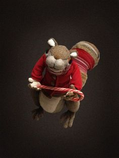 This squirrel is made from a pair of tights, a knee-high sock, a shorter sock, felt swatches, two shirts, a fleece sweater, a scarf, a hat, ...