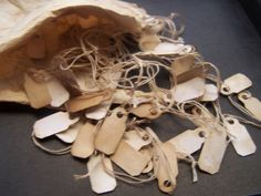 Old Price tags  with hanging string Distressed  Vintage jewerly display retail antique shop