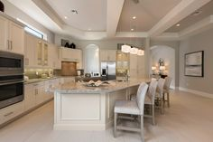 French-inspired kitchen ~ Cipriani model home at Quail West, by McGarvey Custmo Homes ~ Interior design by Cherie Baer, Robb & Stucky Naples ~ Photo by Michael McVay