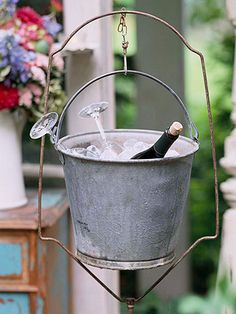 Chill Bottles with Charm ~   No need to buy an expensive wine bucket for entertaining. Repurpose an old galvanized pail for a charming wine and beverage bucket