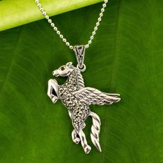 NOVICA Handmade Marcasite and Garnet Pegasus Pendant Necklace ($54) ❤ liked on Polyvore featuring jewelry, necklaces, garnet, pendant, sparkly necklace, pendant jewelry, marcasite necklace, novica jewelry and garnet pendant necklace