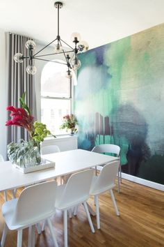 This unique wallpaper is the perfect compliment to this dining room.