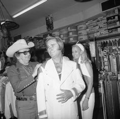 May 26th, 1973, Los Angeles, California– Nudie Cohn, George Jones and Tammy Wynette. Nudie Cohn outfitted many Country & Western stars in custom suits & shirts. — Image by © Michael Ochs Archives