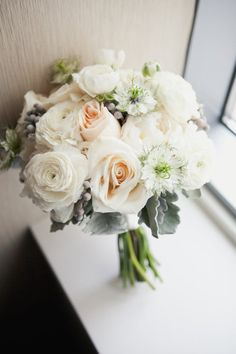 pale bouquet... wonder what the white star-like flowers are called