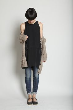 buckle strap flat, worn/washed jeans, black alpha dress worn as a blouse, over sized cable knit sweater.