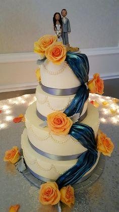 Navy blue draping wedding cake