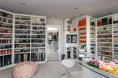 This Closet is Twice the Size of a Normal Home// closet design, tufted pouf, Hermes, shoe closet