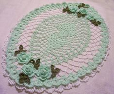 mint green oval crocheted doily