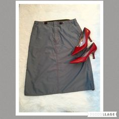 """GAP Parachute Material Skirt, Gray, Med Super cute skirt that is very comfortable. Made a 100% polyester. Grey with red stitching and pull cord accents. 32"""" waist and 26"""" length. From a smoke and pet free home. GAP Skirts"""
