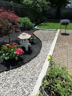 Love the different textures here- mulch against stone. Great drainage for wet parts of the yard. #landscapingnearmeyelp #gardendesign