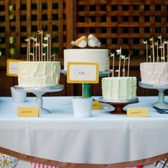 Instead of a multi-tiered cake, this couple opted for multiple single-tiered cakes with creative toppers to complement their DIY theme.