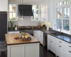 Honed Absolute Black countertops and a butcherblock island